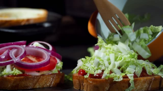 making hot sandwiches with eggs and vegetable - chopped lettuce stock videos & royalty-free footage