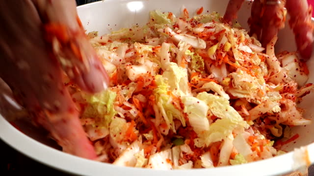 Making kimchi: mixing and massaging the vegetables