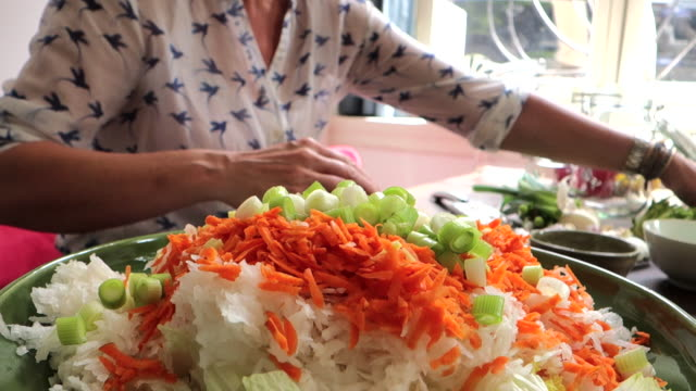 making kimchi: squeezing and adding garlic - carrot stock videos & royalty-free footage