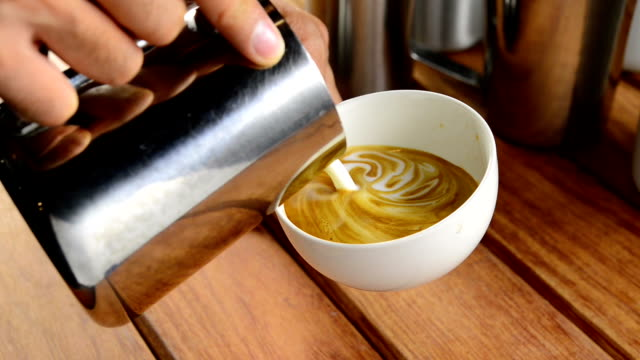 making latte art coffee - froth art stock videos and b-roll footage