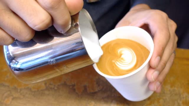 making latte art coffee. - take away food stock videos & royalty-free footage