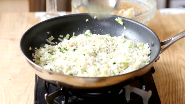 making leek asparagus risotto - risotto stock videos & royalty-free footage