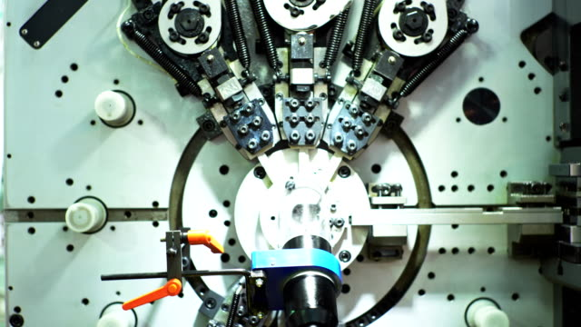 making machine produces using intricate tools attached to various robotic arms. - manufacturing machinery stock videos & royalty-free footage