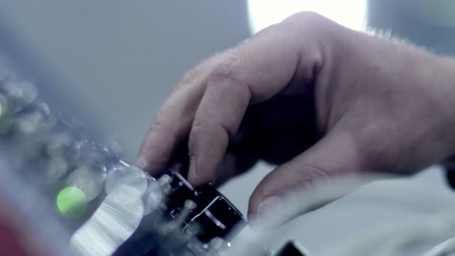 making music. mixing console. hands close up - pannello di controllo video stock e b–roll