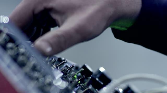 vídeos de stock e filmes b-roll de making music. mixing console. hands close up - teclado numérico