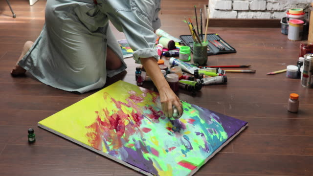 making new art piece with spray - canvas stock videos & royalty-free footage