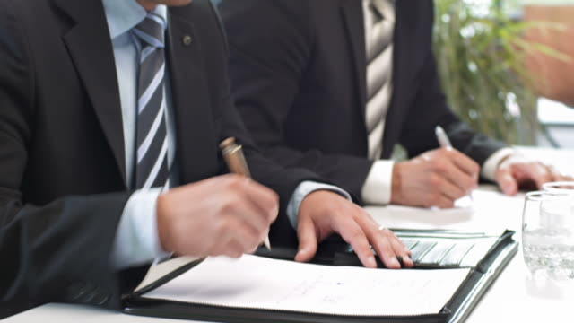 hd: making notes at business meeting - business talk stock videos & royalty-free footage