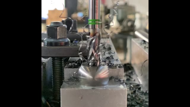 stockvideo's en b-roll-footage met making nut thread on metal part in slow motion - piercen