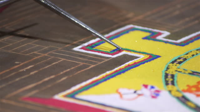 c/u making of a buddhist sand mandala - mandala stock videos & royalty-free footage