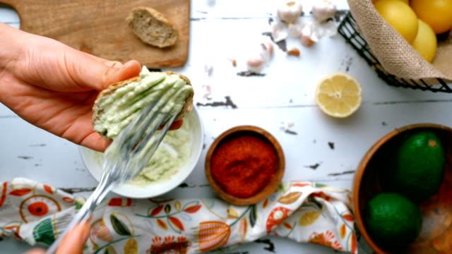 making of creamy avocado paste - spread avocado paste on bread - avocado salad stock videos & royalty-free footage