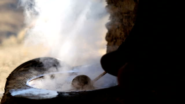 making of molasses in traditional way - molasses stock videos and b-roll footage