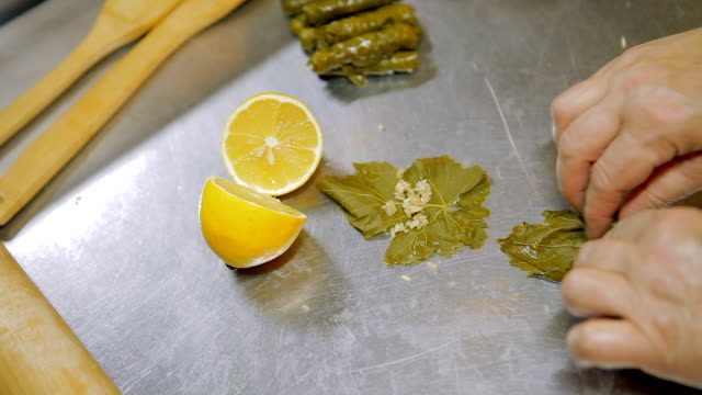 making of stuffed grape leaves - grape leaf stock videos & royalty-free footage