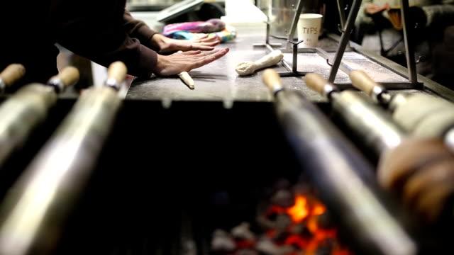 making of trdelnik pastries in prague - prague stock videos & royalty-free footage