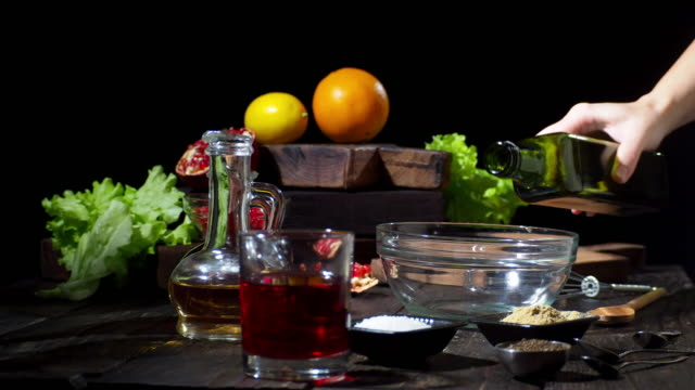 making orange and pomegranate salad - vinegar stock videos & royalty-free footage