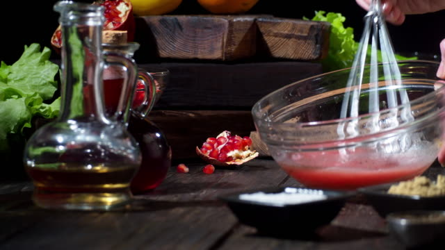 making orange and pomegranate salad - salad dressing stock videos & royalty-free footage