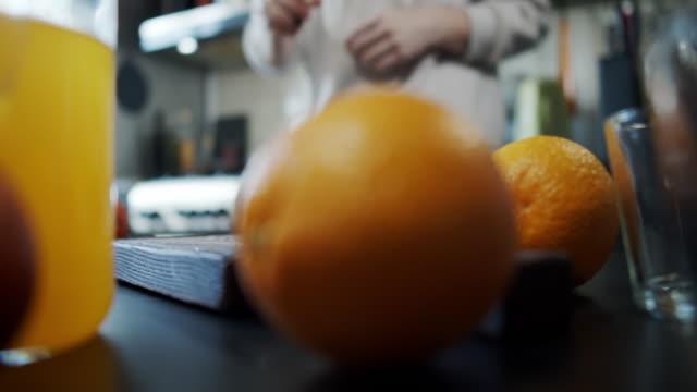 making orange juice - squeezing stock videos & royalty-free footage