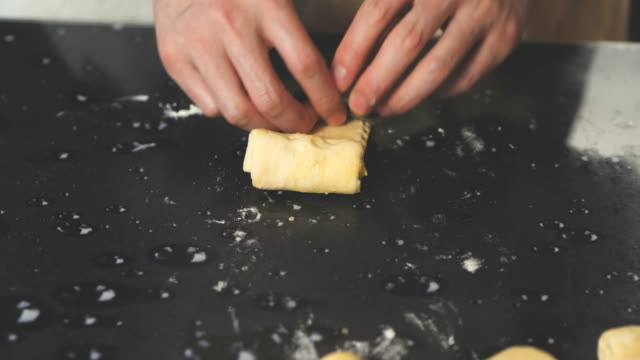 making pain au chocolat - pain au chocolat stock videos and b-roll footage