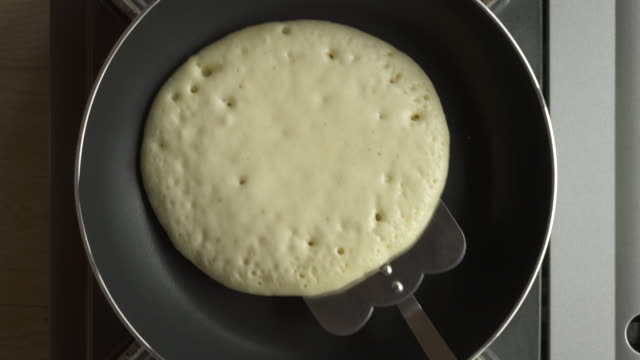 making pancake on frying pan - pancake stock videos & royalty-free footage