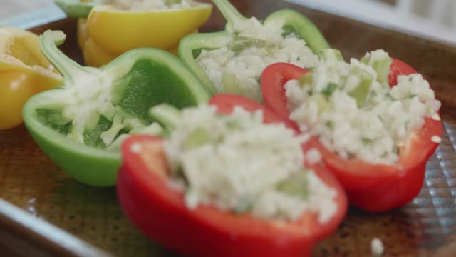 making pepper with stuffing vegetarian risotto - stuffed stock videos & royalty-free footage