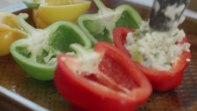 making pepper with stuffing vegetarian risotto - risotto stock videos & royalty-free footage