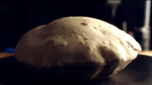 stockvideo's en b-roll-footage met het maken van pita brood in brand. tafelblad geschoten - table top shot