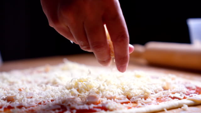making pizza - cheese stock videos & royalty-free footage