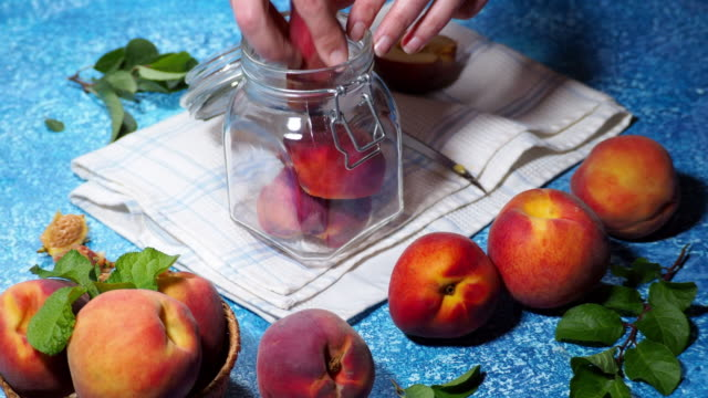 making preserved peaches - jam stock videos & royalty-free footage
