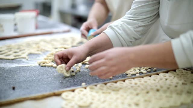 Making pretzels in bakery
