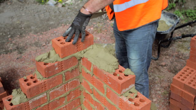 making progress building a wall - brick stock videos & royalty-free footage