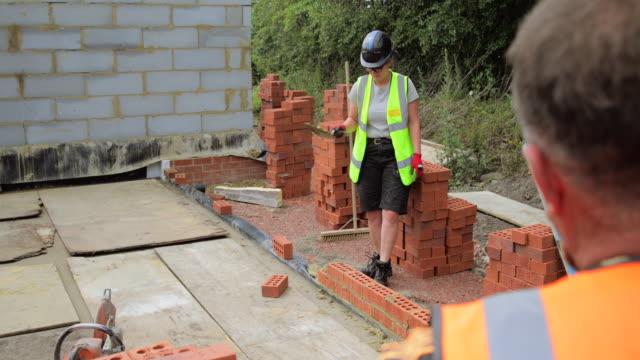making progress - brick stock videos & royalty-free footage
