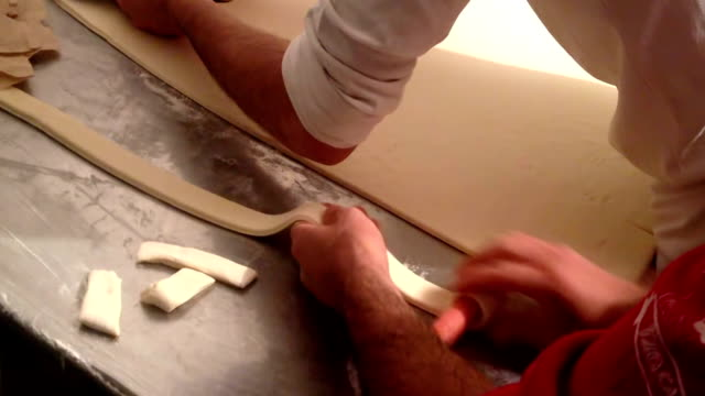 making puff pastry wrapped hot dogs - puff pastry stock videos & royalty-free footage