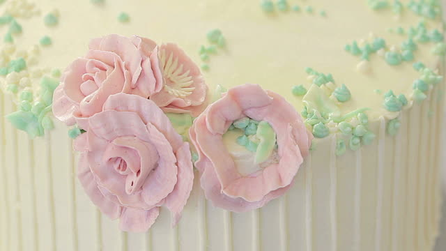 making rose decoration on cake - decoration stock videos & royalty-free footage