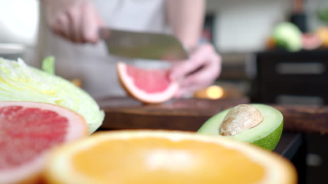 making salad with grapefruit and avocado - slice stock videos & royalty-free footage