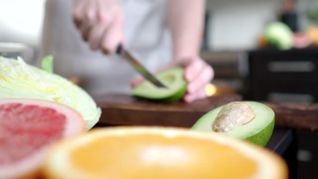 making salad with grapefruit and avocado - avocado salad stock videos & royalty-free footage