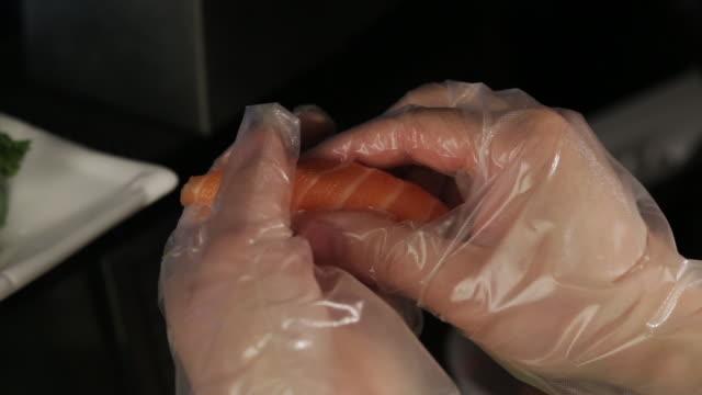 making salmon nigiri. - nigiri stock videos and b-roll footage