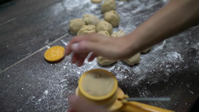 making salted egg yolk mooncake in traditional way - egg yolk stock videos & royalty-free footage