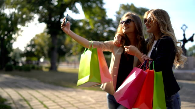 making selfies after shopping - shopaholic stock videos & royalty-free footage