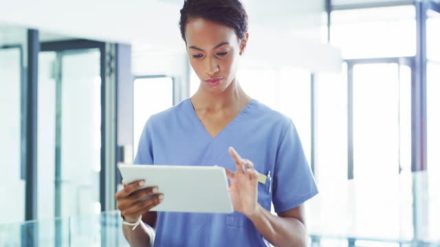 making smart surgical decisions with smart technology - using digital tablet stock videos & royalty-free footage