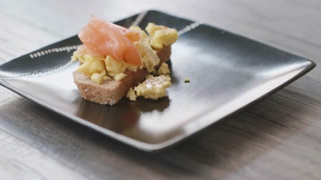 making smoked salmon with scrambled eggs with summer salad - salmon salad stock videos & royalty-free footage