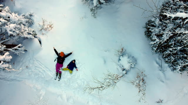 making snow angels - winter video stock e b–roll