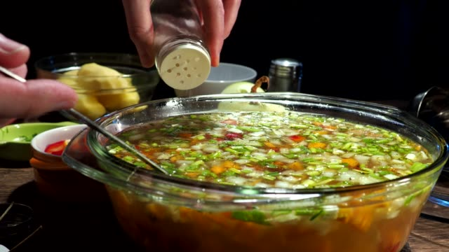 making soup - adding salt stock videos & royalty-free footage