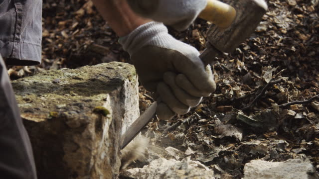 making straight edge on stone - stone material stock videos & royalty-free footage
