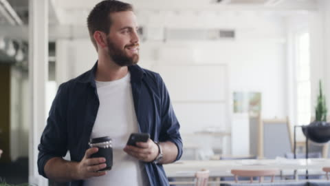 making success happen with coffee and connectivity in hand - cell stock videos & royalty-free footage