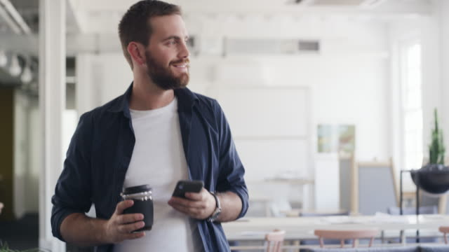 making success happen with coffee and connectivity in hand - only men stock videos & royalty-free footage