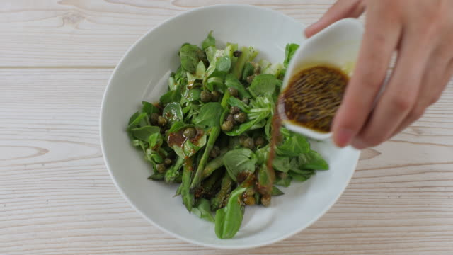 making summer asparagus salad - salad dressing stock videos & royalty-free footage