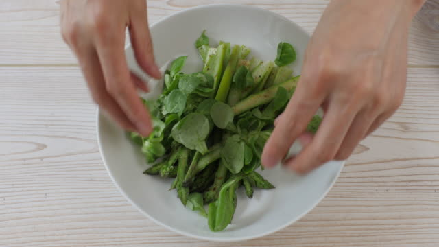 making summer asparagus salad - salad bowl stock videos & royalty-free footage