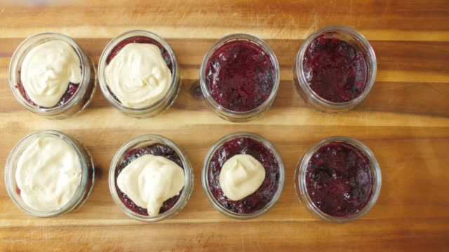 making summer fruit trifle - custard stock videos & royalty-free footage