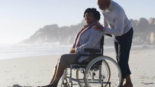 making sure she is always comfortable - paraplegic stock videos & royalty-free footage