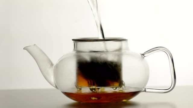making tea in a glass teapot - black tea stock videos & royalty-free footage