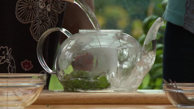 making tea in glass tea pot - teapot stock videos & royalty-free footage